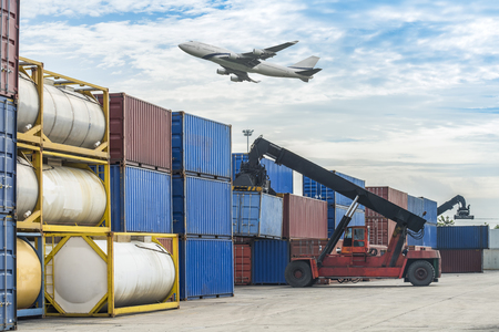 handling: forklift handling the container box in logistic zone