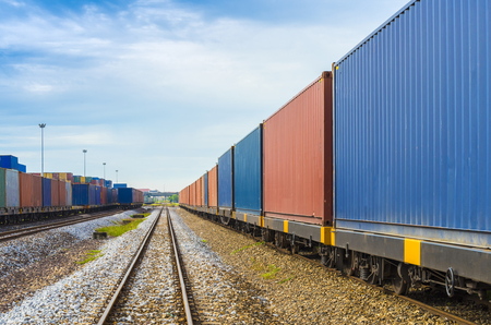 shipyard: train with container in shipyard for Logistic Import Export background Stock Photo