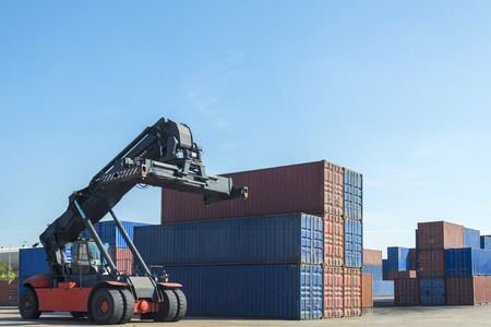 container box: forklift handling the container box in logistic zone