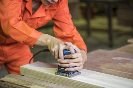 Carpenter with an electric router Reklamní fotografie