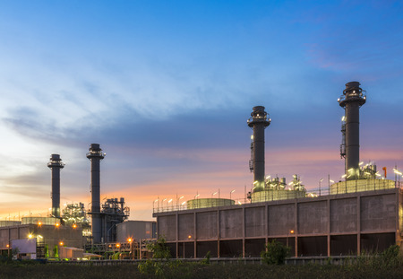 Modern Power Plant with Sunset