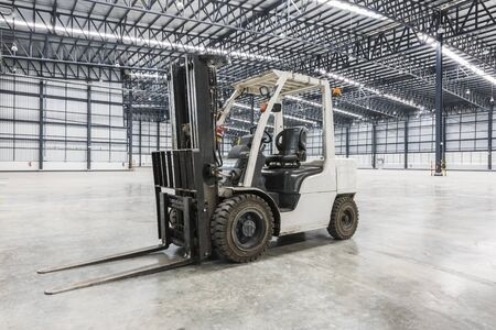 experienced operator: forklift in a modern warehouse at factory Stock Photo