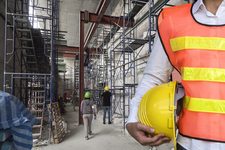 safty engineer with building under construction Stockfoto