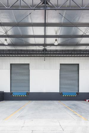 shutter door: two Dock leveler and shutter door in Logistic Area Stock Photo
