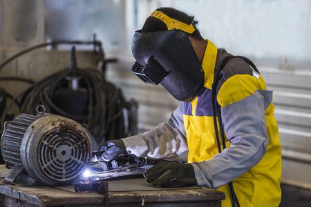 Worker welding the steel part by manual Standard-Bild