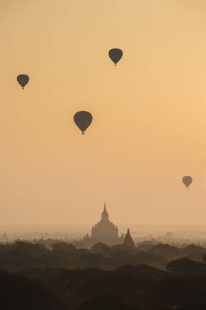 air balloons over Buddhist temples with sunrise at bagan myanma