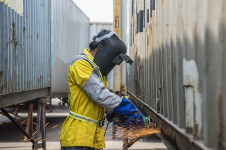 work worker: Manual worker work in Port with grinder Stock Photo