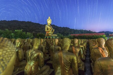 Golden Buddha statue at Buddha Memorial Park with startrail, Thailand
