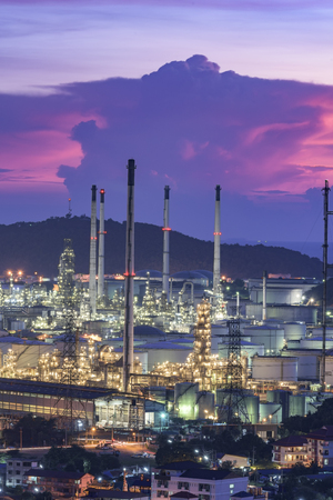 Landscape of oil refinery industry with oil storage tank at sunset