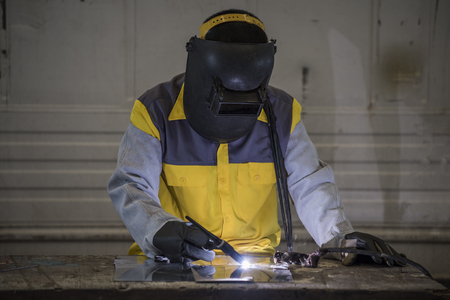 Worker welding the steel part by manual Reklamní fotografie - 50345116