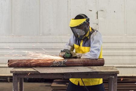Manual worker work in factory with grinder Reklamní fotografie - 50247936