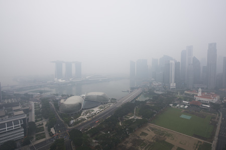 Haze fills the Marina Bay area. Haze from the forest fire and burning of plantation in Indonesia. 에디토리얼