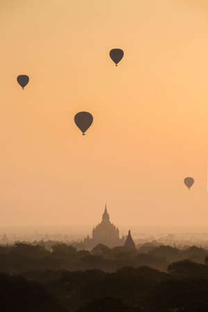 Air balloons over Buddhist temples with sunrise
