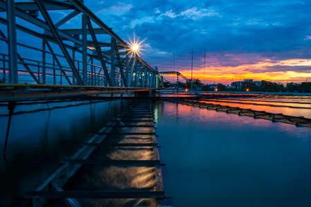Water Treatment Plant with sunset sky Foto de archivo