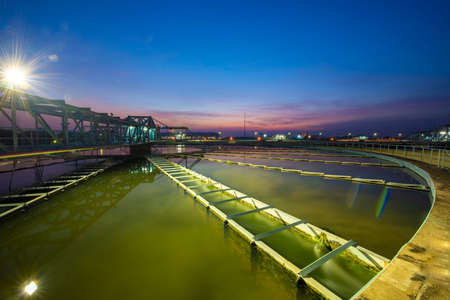 water treatment plant with sunrise Imagens