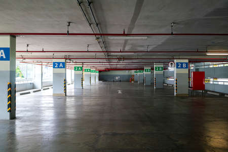 empty modern parking lot garage building in shopping mall because city lock down during coronavirus or covid-19 virus outbreak situation. transportation, coronavirus or city lockdown concepts