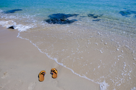 sunny: Shoes on the beach. at samilar beach, songkhla, Thailand Stock Photo