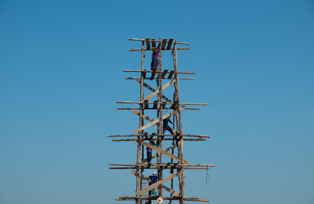 scaffolds: Construction workers against bluesky on wooden scaffolding