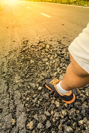 rough road: Man leg walking on rough road