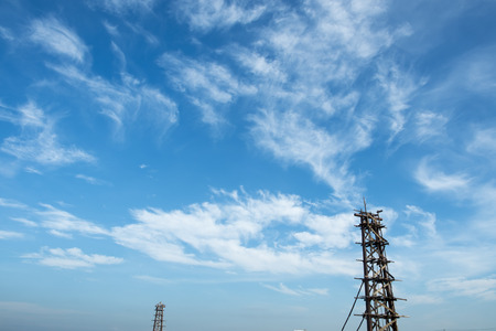 scaffolds: Bridge in construction against blue sky and fluffy clouds Stock Photo