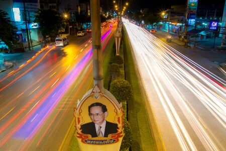 birth day: BANGKOK THAILAND-NOVEMBER 23 2015 : Long exposure light on Sihaburanukit Road. celebration lights decoration for father day King of Thailand birth day at Minburi district in Bangkok, Thailand Editorial