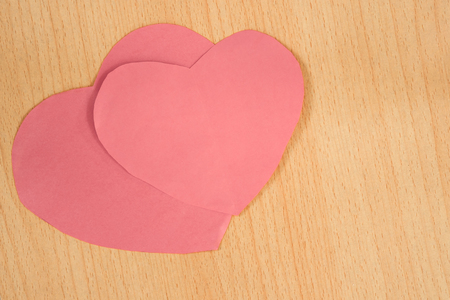 valentine s: Pink paper heart on wood background, Valentine s Day, Pastel Tone. Stock Photo