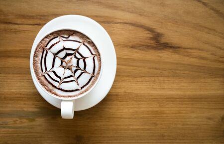 hot cocoa: Creamy hot cocoa drink on wooden table. Top view. Stock Photo