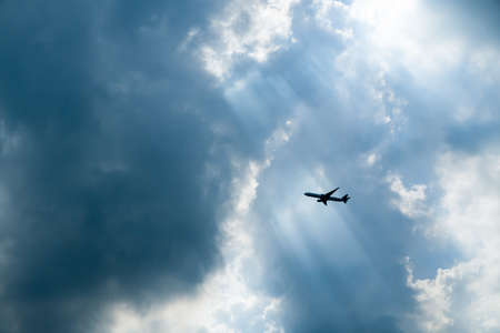 ray trace: Passenger airplane in the clouds and sun-ray. Stock Photo