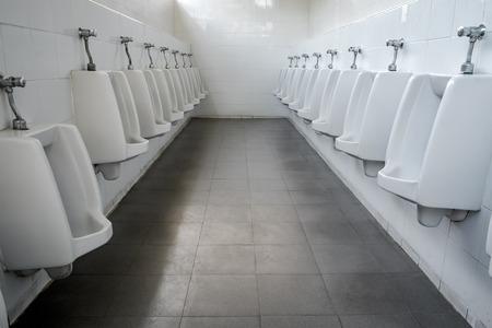 chrome man: Row of white ceramic urinals men public toiletrestroom.