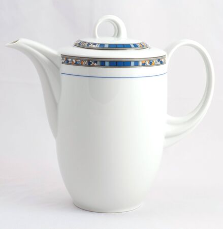 sophistication: white porcelain teapot decorated with blue and orange frame Stock Photo
