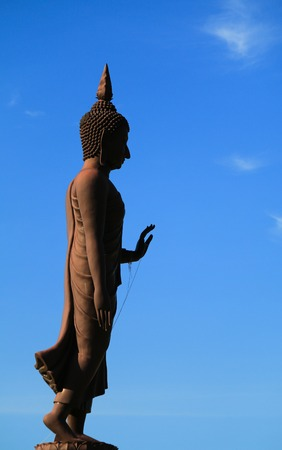 supplicate: Big Buddha Statue with nice blue sky background Stock Photo