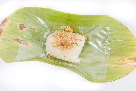 Thailand dessert.Sticky rice Steamed custard and  Sticky rice Fish.Thailand dessert wrapped in banana leaves isolated on white background