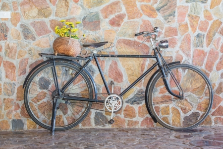 Antique bicycle with flowers.