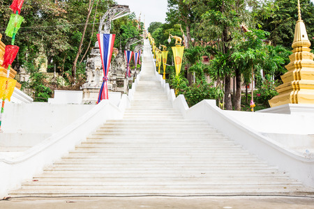 Stairs up to the temple at the festival in thailand. photo