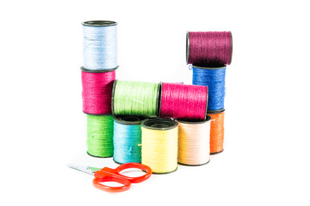 Colorful sewing threads on white. photo