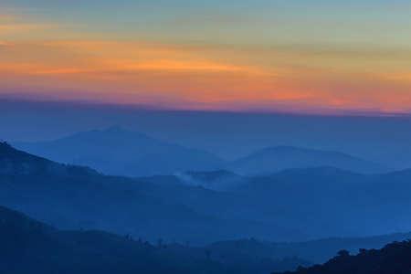 sunset mist mountain winter.