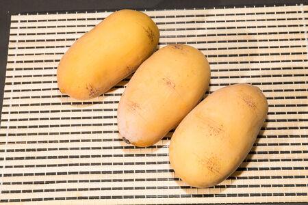 Potatoes on wooden floor