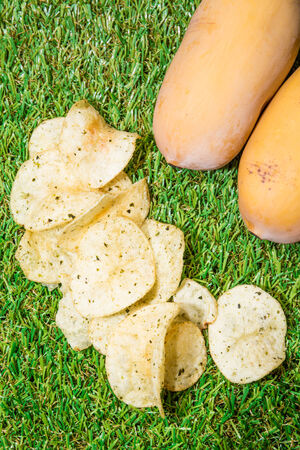 Fried potatoes, cut into pieces, mixed spices.on green grass