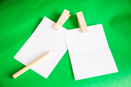 The paper notes with clip on green background