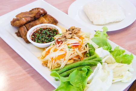 green papaya salad: rice green papaya salad  fried Chicken,Popular Food Thailand. Stock Photo