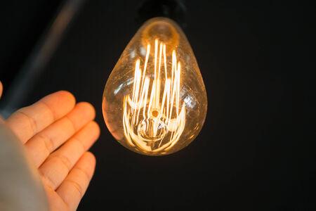edison: With Edison bulbs. Illuminating