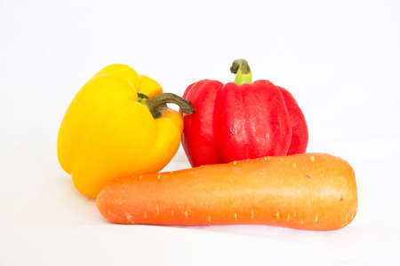 Fresh vegetables sweet Red, Yellow, Peppers and Kat carrot isolated on white background. Stock Photo