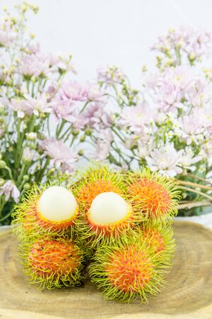 Fresh red rambutan sweet delicious fruit. Plum-sized tropical fruit with soft spines.