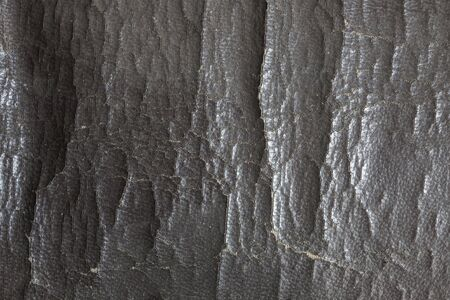 instrument panel: Sofa damaged skin cracks. Stock Photo