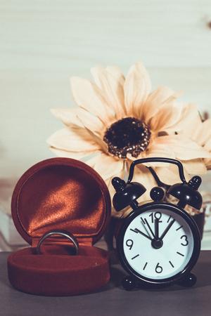 Wedding ring and alarm clock, vintage filter