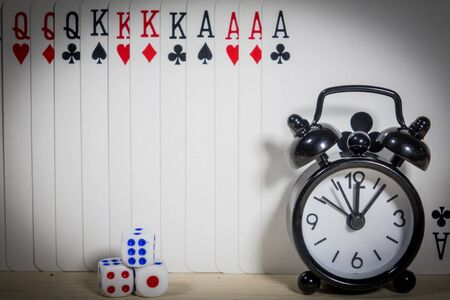 Poker of cards, dice and clocks Stock Photo