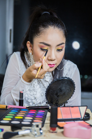Multi-make-up,Brunette woman applying make up  Is using makeup equipment