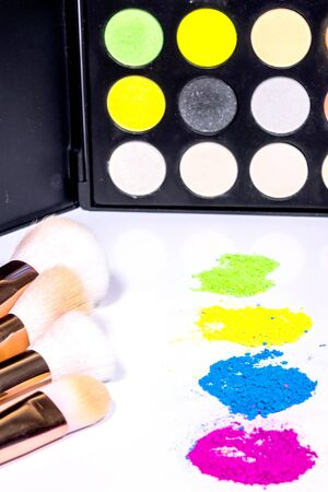 Colorful make-up with make-up brushes isolated on a white background. Stock Photo