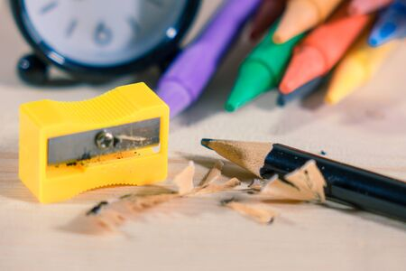 Sharpened Pencil on wooden background