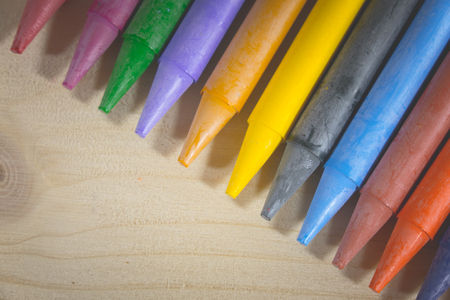 Crayon, many colorful used in art on a wooden background.